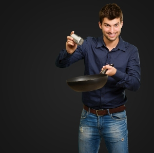 This is not my husband, but this IS the only cooking tool he knows how to use. Gotta love a stir-fry!  Photo credit:dadsthatcook.com